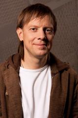 man smiling in jacket