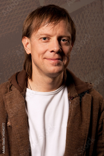 man smiling in jacket