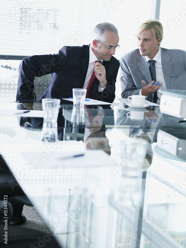 Two businessmen meeting in a boardroom