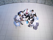 Aerial view of a group of office workers meeting in a rotunda