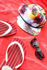 Flip flops, sunglasses and a cap