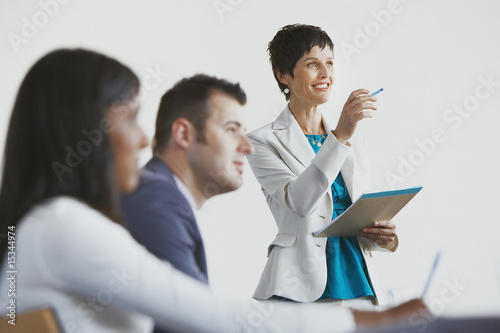 Businesswoman facilitating group meeting