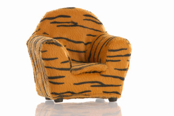 leopard print chair with reflection on white background