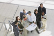 Group of businesspeople with blueprints