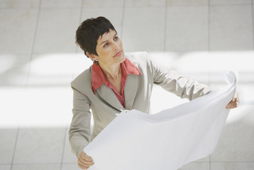 Aerial view of businesswoman with blueprints