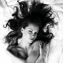 Young woman with magnificent scattered hair
