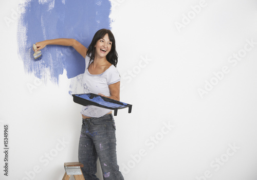 Woman painting and laughing