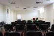 empty classroom / conference room with chairs and flipchart
