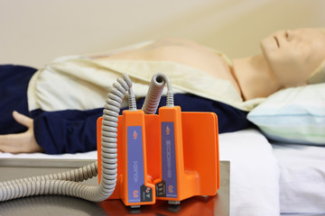 medical dummy with defibrillator