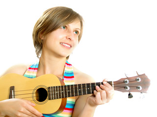 Attractive girl playing a Hawaiian guitar