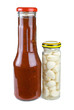 Bottles with tomato ketchup and marinated garlic