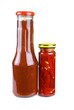 Bottles with tomato ketchup and marinated red hot chili peppers