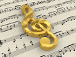 Golden treble clef on score sheet