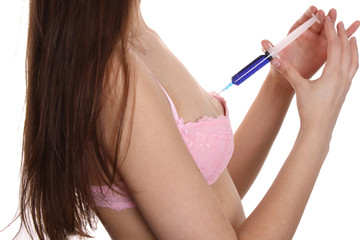 breasts and syringe