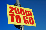 encouraging sign saying 200m to go poster
