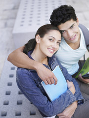 Young student couple hugging and posing