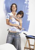 Man and woman covered in paint embracing