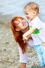 loving mother and son on beach