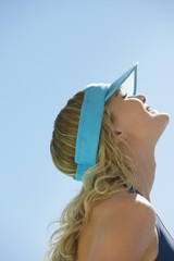 Profile of woman in visor outdoors