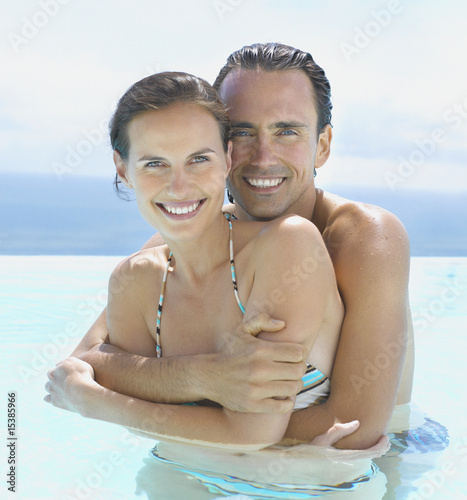 Man and woman embracing in water