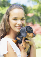 Teenage girl with puppy dog