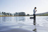 Man kneeling on water praying