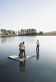 Man walking on water with man and woman watching