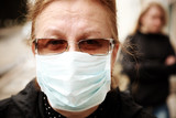 woman protecting herself against influenza with a face mask poster