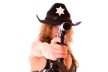 Beautiful sheriff woman shooting with gun isolated on white
