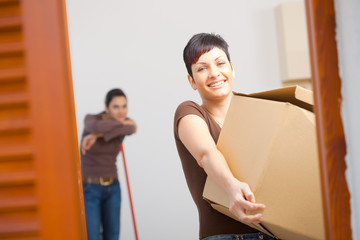 Young woman with cardboard box
