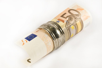 A rolled up fifty euros bill in a silver napkin ring