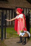 Girl in red opening gate