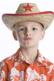 Portrait of a little boy with a sheriffs hat poster