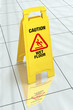 """Caution - Wet Floor"" sign on tiled floor, with clipping path"