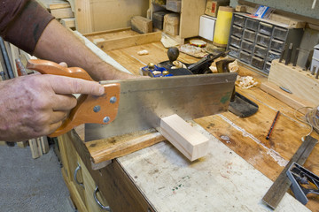 Sawing on workbench