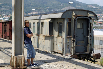 Boy in abandoned train station