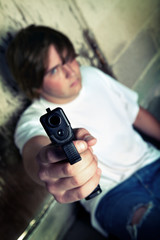 teen angry with handgun