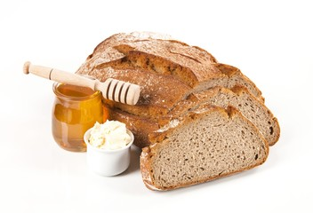 Fresh bread, butter and honey