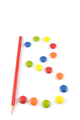 Letter B made of colored smartie