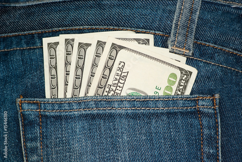 Jeans pocket with $100 bills