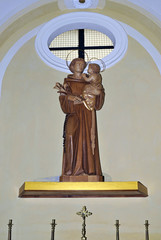 Italian Church station with devotional Saint Antonio wood statue