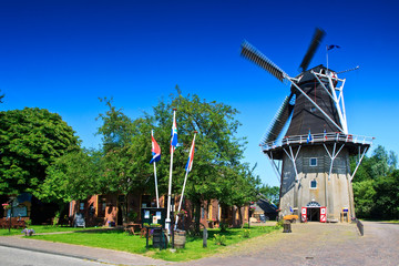 Dutch wind mill in a village