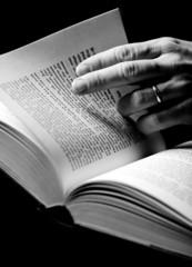 hand thumbing through a book