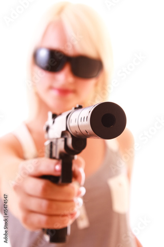 Beautiful woman aiming with gun isolated on white