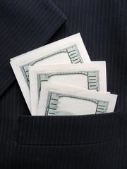 hundred dollars banknotes in pocket of black jacket