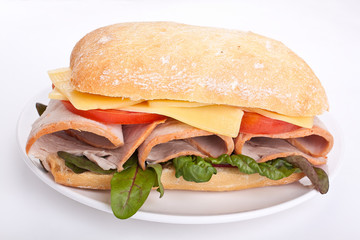 Ciabatta sandwich with meat,cheese and vegetables