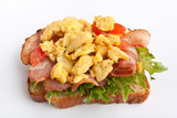 hot sandwich with fried bacon, scrambled eggs and lettuce poster