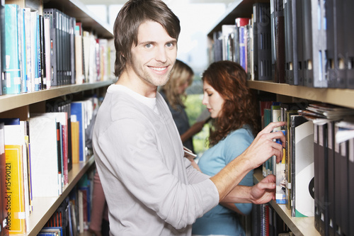 Young Man in library at school