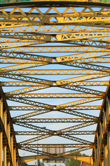 Girder of an old yellow steel bridge