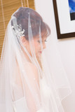 Close up bride to be hidden in veil poster